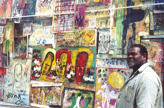 Purvis Young, one of South Florida's most storied artists, with one of his murals in Fort Lauderdale in 2003.