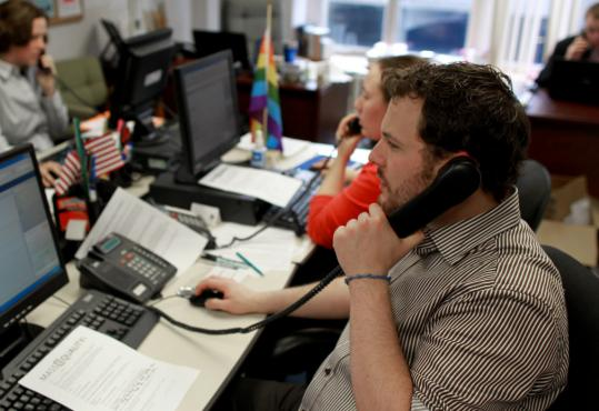 PHOTOS BY JONATHAN WIGGS/GLOBE STAFF Ryan Brown, manager of field operations, worked the phones at MassEquality last week during an effort to garner support for the transgender rights bill.