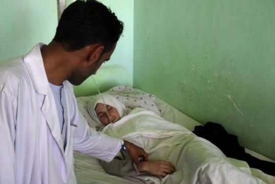 A medic checked on a schoolgirl in a hospital in Kunduz, north of Kabul, yesterday.