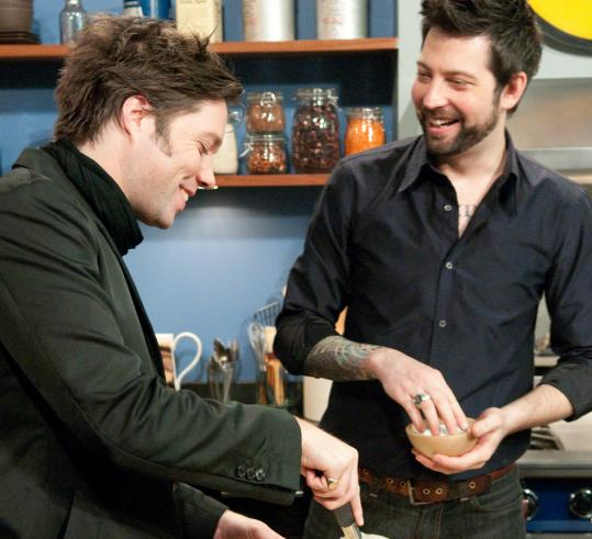 "Rufus Wainwright (left) mixes things up under the supervision of Sam Mason, executive chef at Tailor in New York, for an episode of ""Dinner With the Band.''"