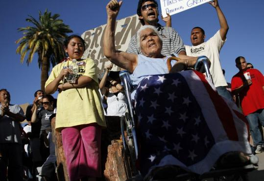 Aurrela Saenz (center), who has been in the United States for 25 years, was among the protesters outside the Arizona State Capitol in Phoenix Sunday.