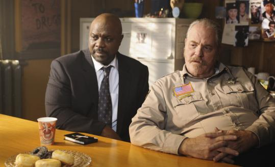 "Robert Wisdom (left) and M.C. Gainey explore secrets and sinister characters in ""Happy Town.''"