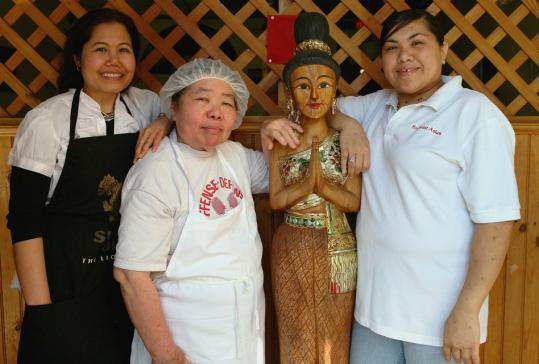 From left: Southeast Asian Restaurant's Kathy Xayyamountry, Phouvieng Louxay, and Pam Chanthachem and their Lao dish moak gai (chicken in banana leaves).