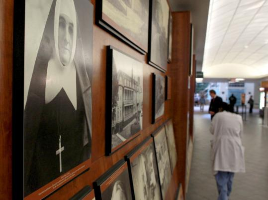 A nun's portrait and other Catholic decor are in prominent view at Saint Vincent Hospital.
