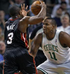 Glen Davis may not have wanted to look, but he still played tough defense on Miami superstar guard Dwyane Wade.