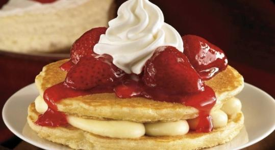 IHOP's Pancake Stackers consist of cheesecake filling, two buttermilk pancakes, a compote, and whipped topping.