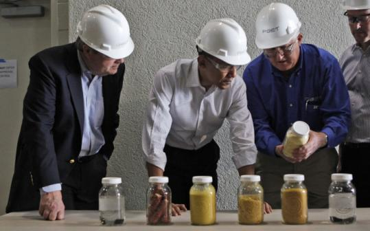 ALTERNATIVE FUEL - President Obama wants to triple ethanol production in 12 years to reduce dependence on foreign oil. Yesterday, agriculture secretary Tom Vilsack and Obama viewed samples at POET Biorefining in Macon, Mo.