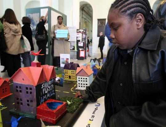 Amani Perkins is among the youngsters who created a fantasy home for Peaceville, which is on display at the State House. His older brother was killed four years ago in a shooting and he has turned to a young survivors program to help cope.