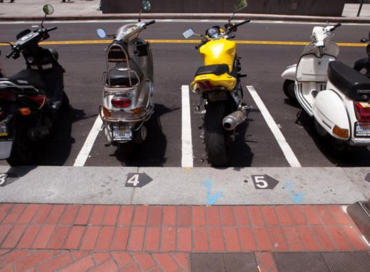 San Francisco&#8217;s on-street bike slots are the model for the ones Boston plans to have in place this summer.