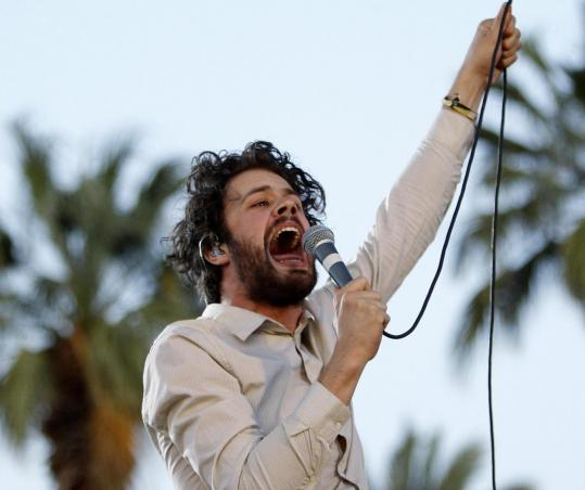 Michael Angelakos leads Passion Pit's electro-tinged screeching with his falsetto singing.