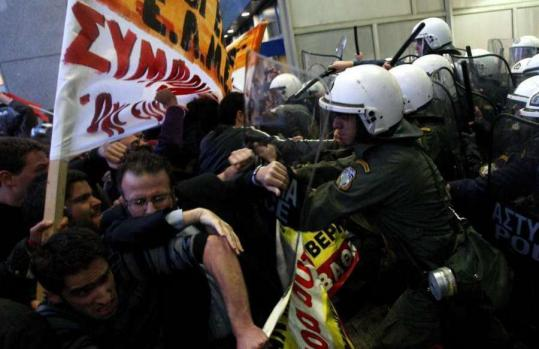 Riot police and protesters clashed outside the Finance Ministry in Athens this week. Greece's economic crisis has left the country in turmoil.