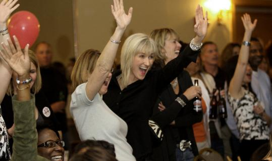 A gathering of 600 showed up to ogle Boston's finest in a fashion show/auction that benefited breast cancer research.