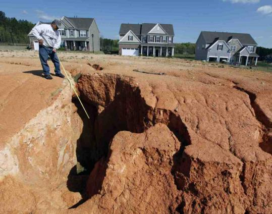 Tom Rosa measured a chasm at the Edenmoor development in Indian Land, S.C. The EPA considers sediment the leading — and most costly to fix — cause of water pollution.
