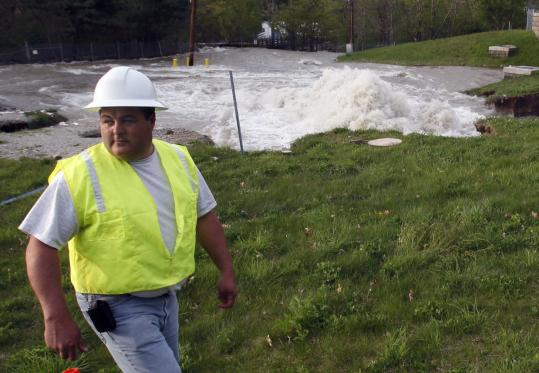 Water surged from the ground in Weston, where a 10-foot-wide pipe ruptured in the morning.