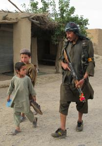 A defense force member patrolled in the Arghandab District. The United States hopes the force will help defeat insurgents.