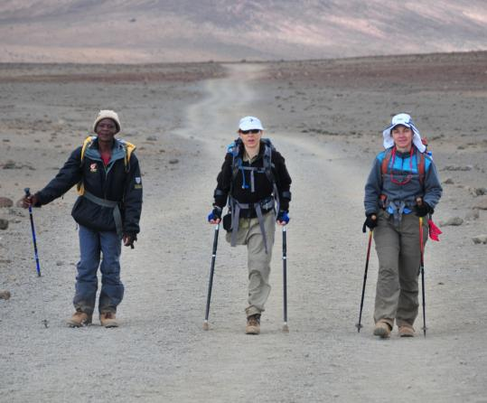 Sarah Doherty (center, on a trail near Mount Kilimanjaro) lost a leg at 13 and is now an occupational therapist who designed a shock-absorbent crutch for a variety of activities.