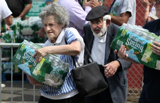 Esther and Milton Walkin and other Malden residents received a case of free bottled water from city officials yesterday.