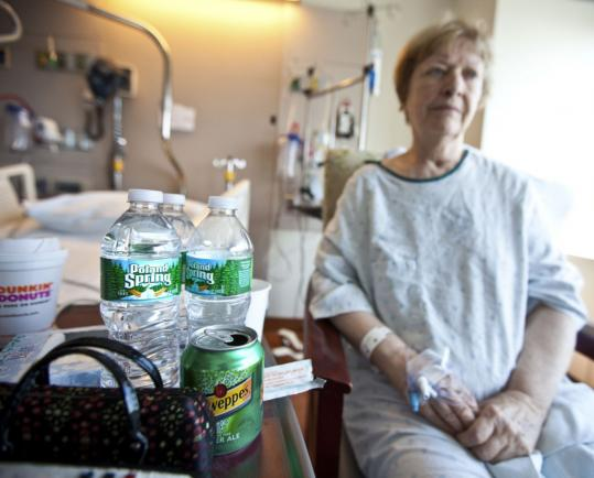 Marilyn Hassett, 76, was given bottled water while recovering from knee surgery at Massachusetts General Hospital. Her family also brought her a cup of coffee yesterday.