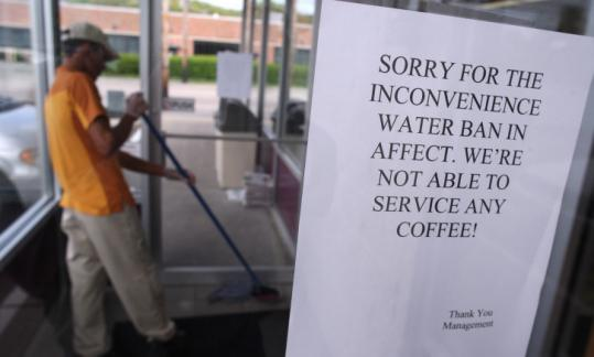 A sign on the door at a Dunkin' Donuts store in Newton yesterday gave coffee-seeking customers some bad news.