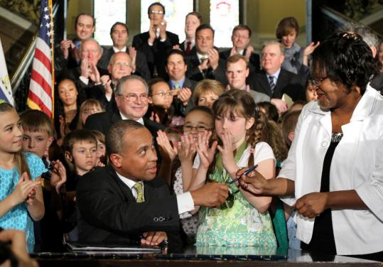 Governor Deval Patrick signed the antibullying bill yesterday and gave the pen to Sirdeaner Walker, whose son Carl Joseph Walker-Hoover, 11, committed suicide after being bullied.