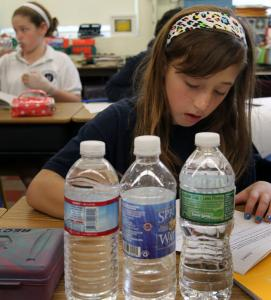 Fifth-grader Ciara D'Amico had her choice of three brands of bottled water yesterday at Eliot K-8 School in Boston.