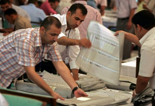 Electoral workers in Baghdad counted ballots from the recent Iraqi parliamentary elections yesterday. A recount was demanded by Prime Minister Nouri al-Maliki's State of Law coalition.