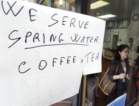 A sign at the Capitol Coffee House in the Beacon Hill neighborhood of Boston yesterday advised customers that coffee and tea were being made using bottled spring water.
