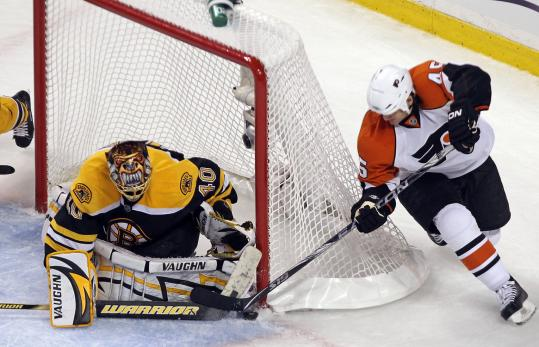 Tuukka Rask manned his post admirably, stuffing this behind-the-net scoring bid by Arron Asham in the second period.