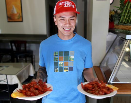 Long Le (pictured) and his brother Tuan opened Brother's Crawfish in Dorchester last month.
