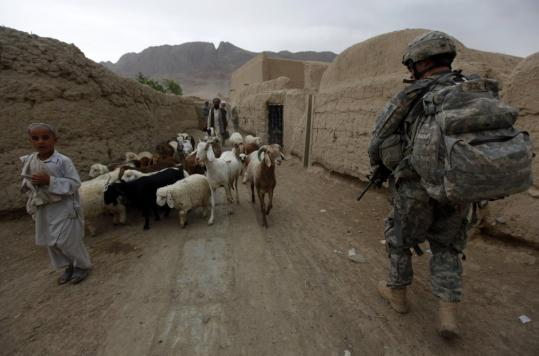 A US soldier patrolled a village yesterday in the Arghandab Valley near Kandahar, in southern Afghanistan, where US-led NATO forces were preparing for a major offensive.