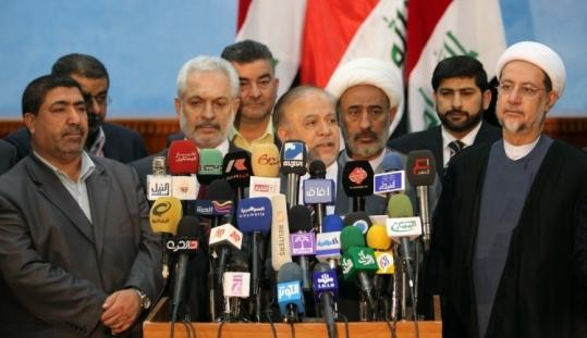 Members of two major Shi&#8217;ite political coalitions, including one led by Prime Minister Nouri al-Maliki and one with close ties to Iran, announced their alliance in Baghdad Tuesday.
