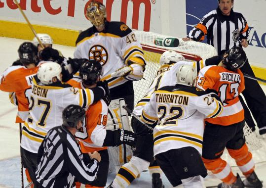 Goalie Tuukka Rask remains out of harm's way as the Bruins and Flyers renew acquaintances in front of the Boston net.