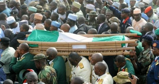 The body of Nigerian President Umaru Yar'Adua was carried from Katsina Stadium to the cemetery yesterday. Thousands of mourners thronged the city of Katsina for the funeral.