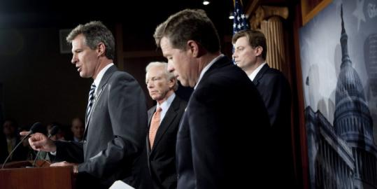 Senator Scott Brown (left) spoke yesterday with other congressional representatives in Washington on a bill aimed at limiting US citizens' support of terrorist groups.