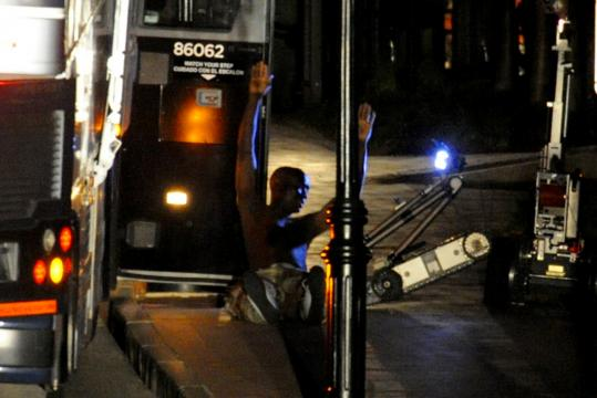 The last passenger to exit the Greyhound bus sat on a Hanover Street sidewalk last night after a tense standoff in downtown Portsmouth, N.H., yesterday. No one was injured in the 10-hour ordeal.