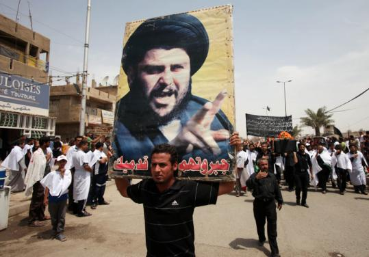 Followers of radical Shi&#8217;ite cleric Moqtada al-Sadr marched in the Sadr City neighborhood of Baghdad last month.