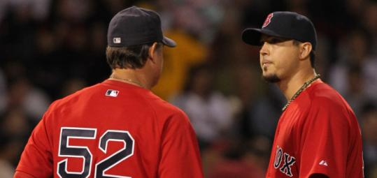 Pitching coach John Farrell visited Josh Beckett during the Yankees' three-run fourth. Beckett allowed nine runs in 5 1/3 innings.