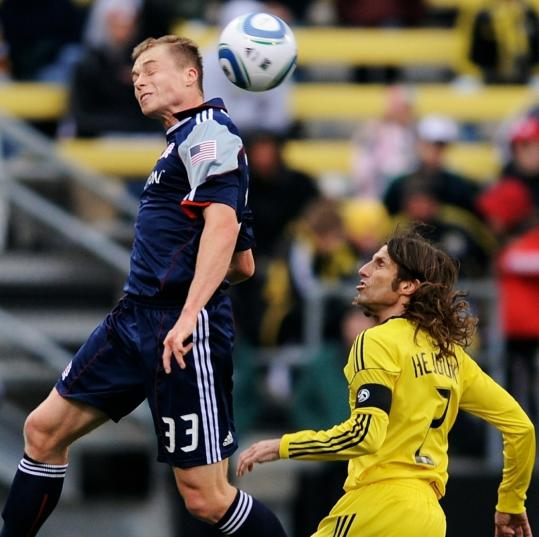 jamie sabau/Getty Images Zak Boggs, who elevated his game by scoring twice, heads the ball away from Frankie Hejduk.