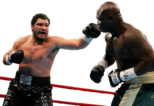 John Ruiz landed a left on James Toney during their World Boxing Association heavyweight championship bout.