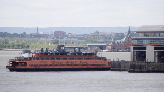 A Staten Island ferry docked in Manhattan yesterday. The ferry that malfunctioned and crashed into a pier Saturday, injuring up to 37 people, has been idled.