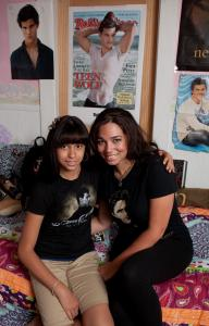 Mary Irizarry and her daughter, Areeana Colon, in front of Areeana's Taylor Lautner posters.