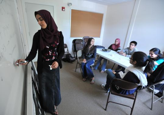 Hajara Shareef teaches a class of teenagers at the Islamic Center of Boston in Wayland.