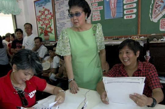 "Imelda Marcos stood next to her son Ferdinand ""Bongbong'' Marcos Jr., who is running for senator, and her daughter Irene, as they cast their votes."