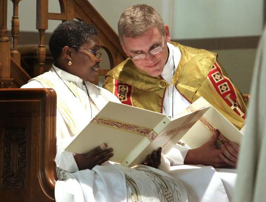 The Rev. Miriam Sedzro, Resurrection pastor, with the Rev. Nathan Pipho of Quincy after her installation last month.