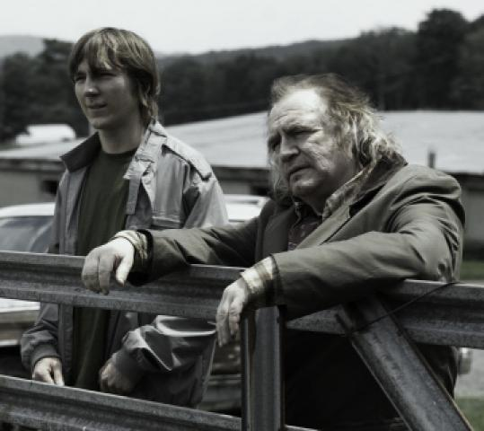 Paul Dano (left) plays a homeless man taken in by Brian Cox's bar owner.