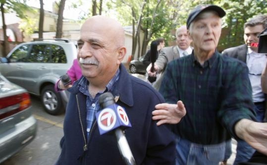 Elias Audy walked past reporters behind one of his Brookline service stations, which FBI investigators searched in connection with the attempted car bombing in New York.