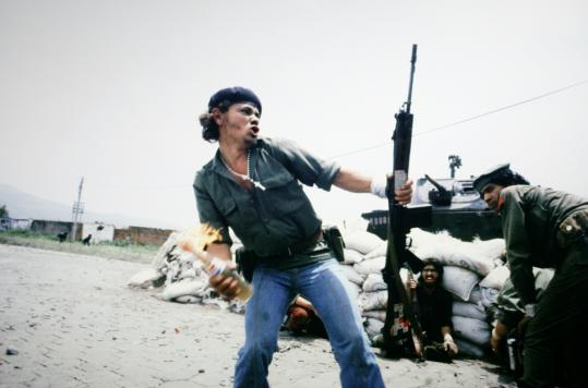 """Susan Meiselas's photographs for Magnum during Nicaragua's civil war include """"Sandinistas at the wall of the National Guard headquarters, Esteli,Nicaragua.'"""