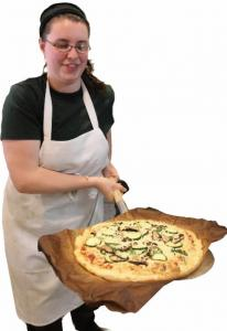 Pizza chef Kirsten Lamb showed a gluten-free pizza fresh from the oven at Peace o' Pie in Allston.