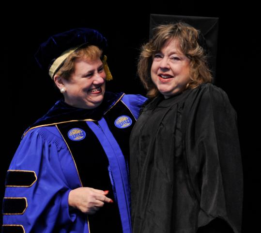 Helen G. Drinan (left), the president of Simmons College, congratulated Faith Gobuty of Palo Alto, a 1973 graduate.