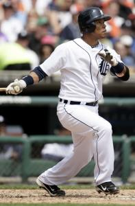 The Tigers' Ramon Santiago watches the flight of his two-run homer off John Lackey in the fourth inning yesterday at Comerica Park. It was his first homer since last Aug. 15.